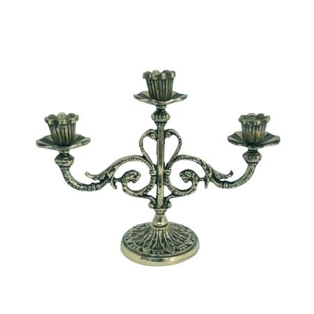 Castiçal de metal dourado para três velas