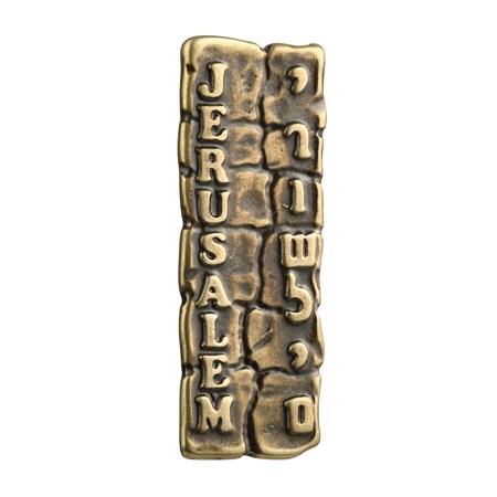 Mezuzá dourada carro muro
